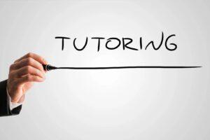 a hand underlining the word tutoring